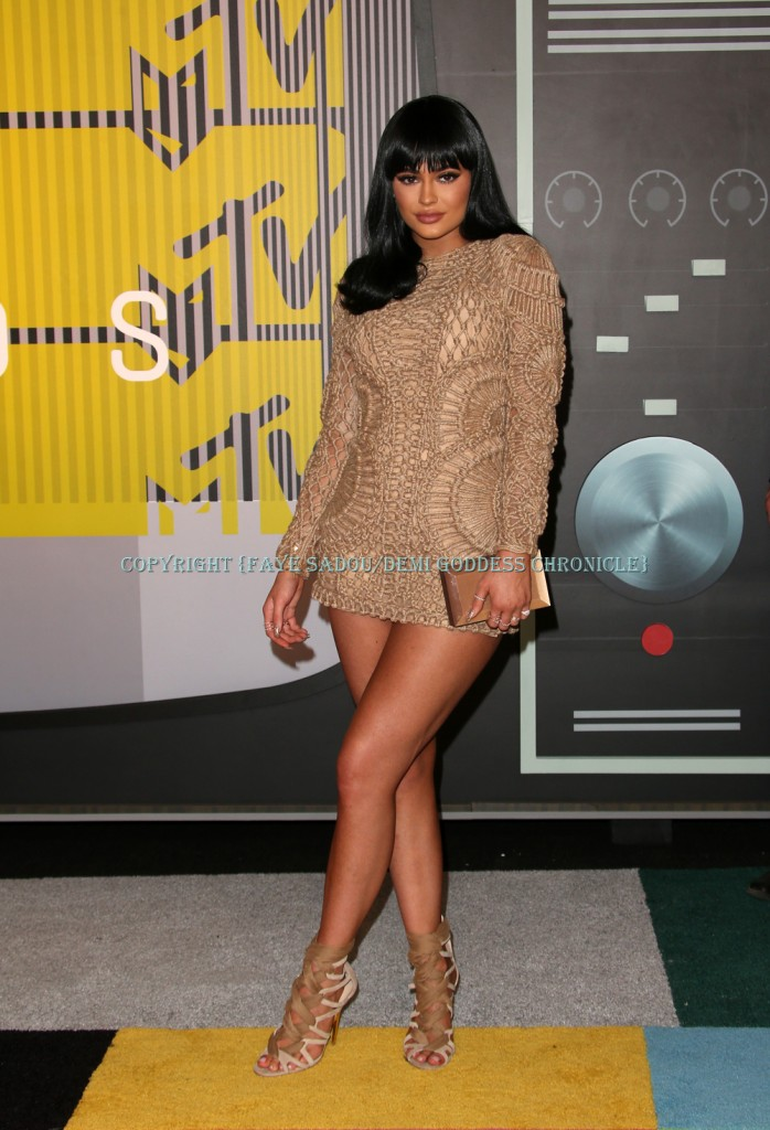 Kylie Jenner in a nude minidress and laced heels at the  2015 MTV Video Music Awards Photo Credit: Faye Sadou/DemiGoddessChronicle.com.