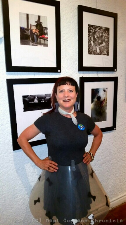 Photographer Lisa Guerrier stands in front of her photographs. Photo credit Demi Goddess Chronicle