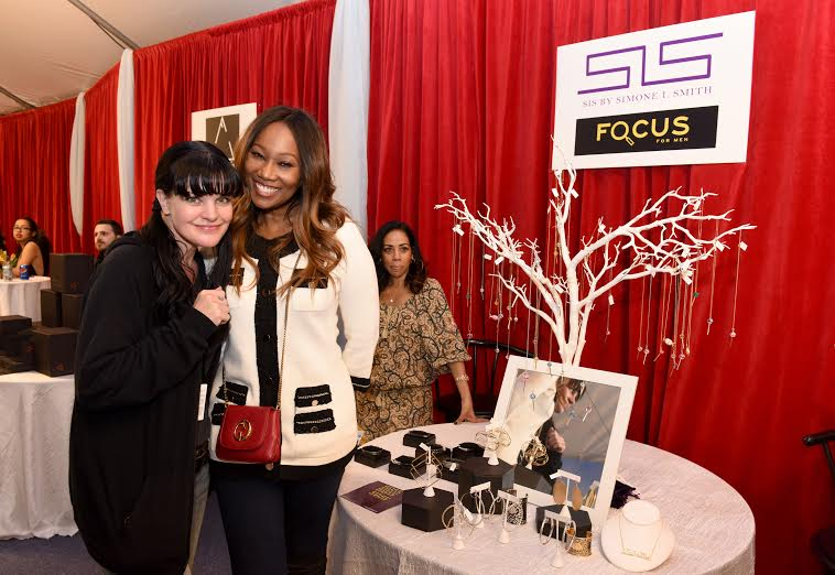 58th Annual GRAMMY Awards® - Pauley Perrette and Yolanda Adams attend Distinctive Assets GRAMMY® Gift Lounge. Photo Courtesy of Distinctive Assets Photo Credit: Vivien Killilea/WireImage