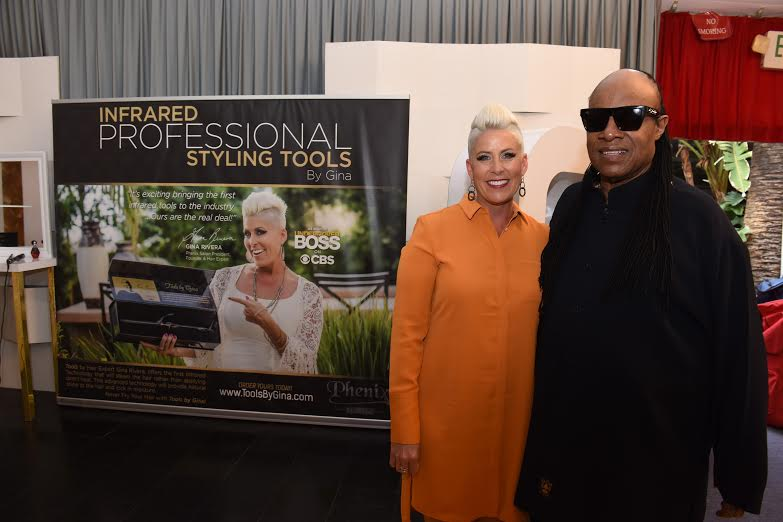 58th GRAMMY® Awards - Musician Stevie Wonder and Gina Rivera (Tools by Gina) attend the Distinctive Assets GRAMMY® Gift Lounge. Photo Courtesy of Distinctive Assets Photo Credit: Vivien Killilea/WireImage