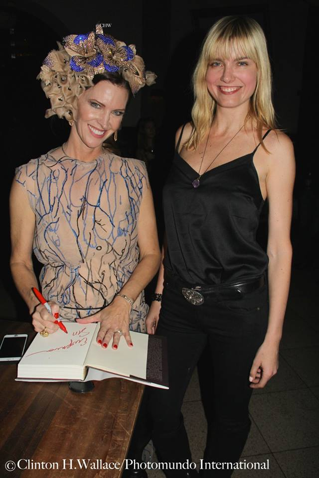 Leslie Zemeckis signs a book for Eugenia Kuzmina. Photo credit: Clinton H. Wallace for Demi Goddess Chronicle
