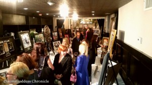 Guest bidding on silent auctions. Photo credit: Demi Goddess Chronicle