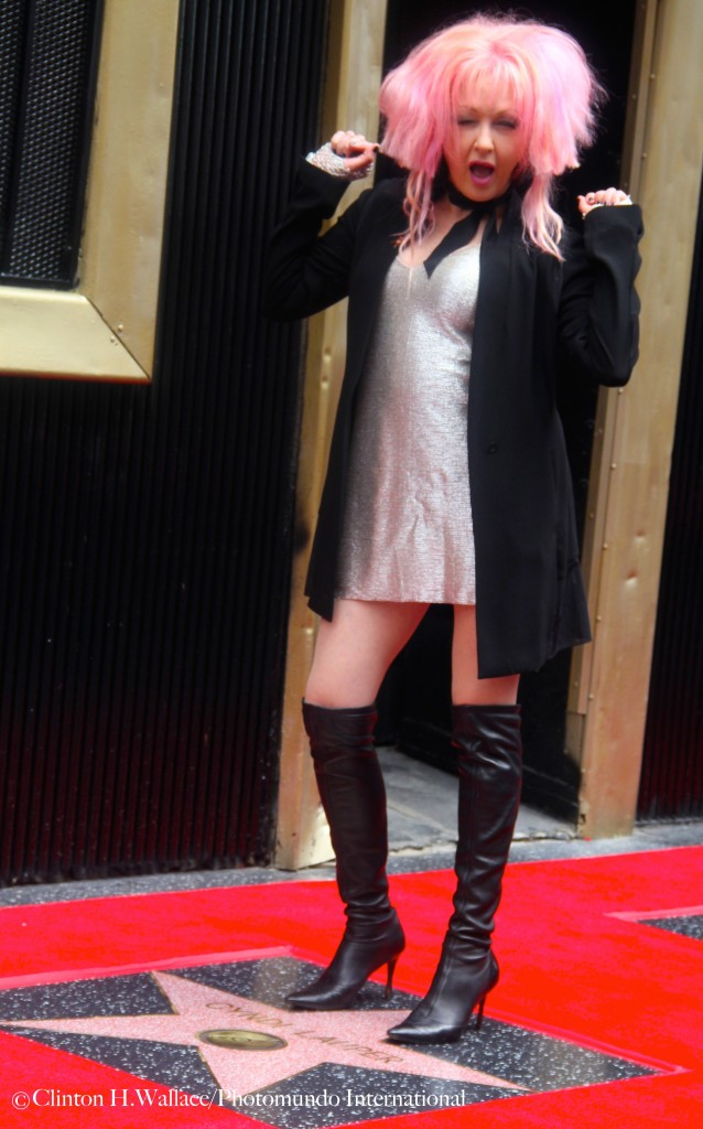 Wearing a silver mini dress and a pair of knee high black leather boots Cyndi Lauper indeed is having fun as she dances atop of her Newly Unveiled Hollywood Walk Of Fame Star ©Clinton H.Wallace/Photomundo International/Demigoddess Chronicle
