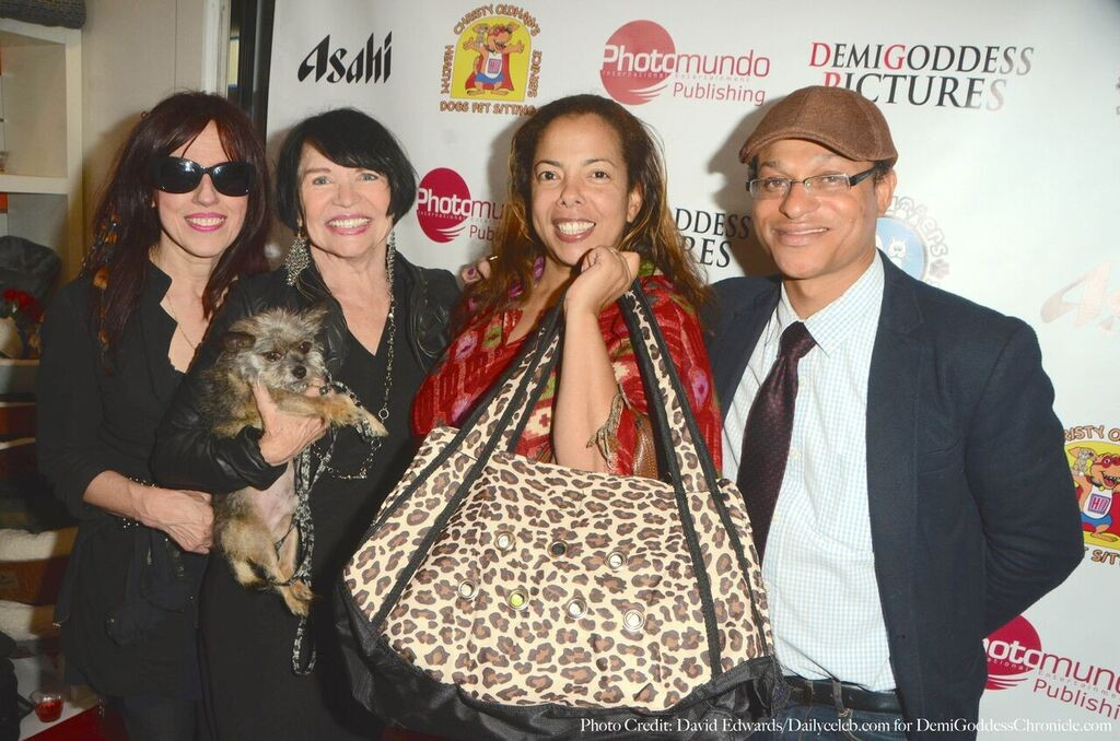Nina Womack wins a Petrosexual designer bag from Marianne Buttner and Barbara Jayne of Lick Magazine. Photo credit: David Edwards/DailyCeleb.com for DemiGoddessChronicle.com
