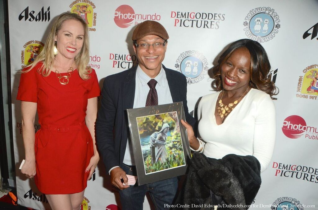 Mounah wins an original Seraphine Print. Photo credit: David Edwards/DailyCeleb.com for DemiGoddessChronicle.com