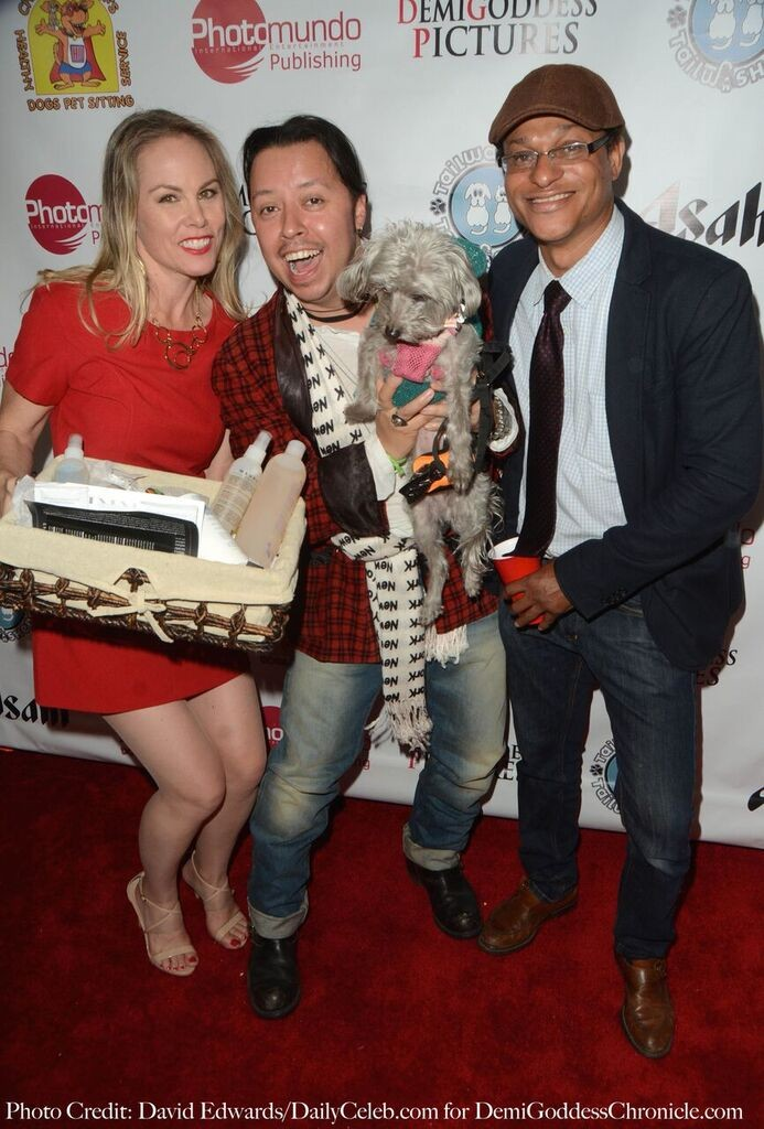 Carlos Ramzey Ramirez wins a Mauro Pet Gift Basket for his dog Lola in the Raffle. Photo credit: David Edwards/DailyCeleb.com for DemiGoddessChronicle.com