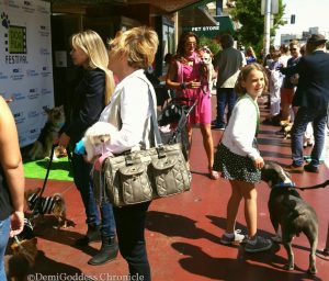 Eager theatre goers and their dogs outside The Crest theatre. Photo by: DemiGoddessChronicle.com