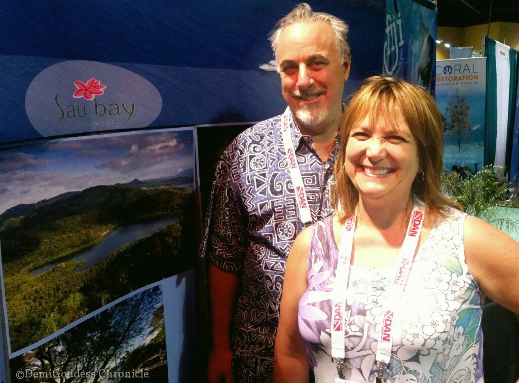 Rhonda & Jim Pisani representing Carol Douglas' Sau Bay Figi Retreat. Photo by Demigoddesschronicle.com