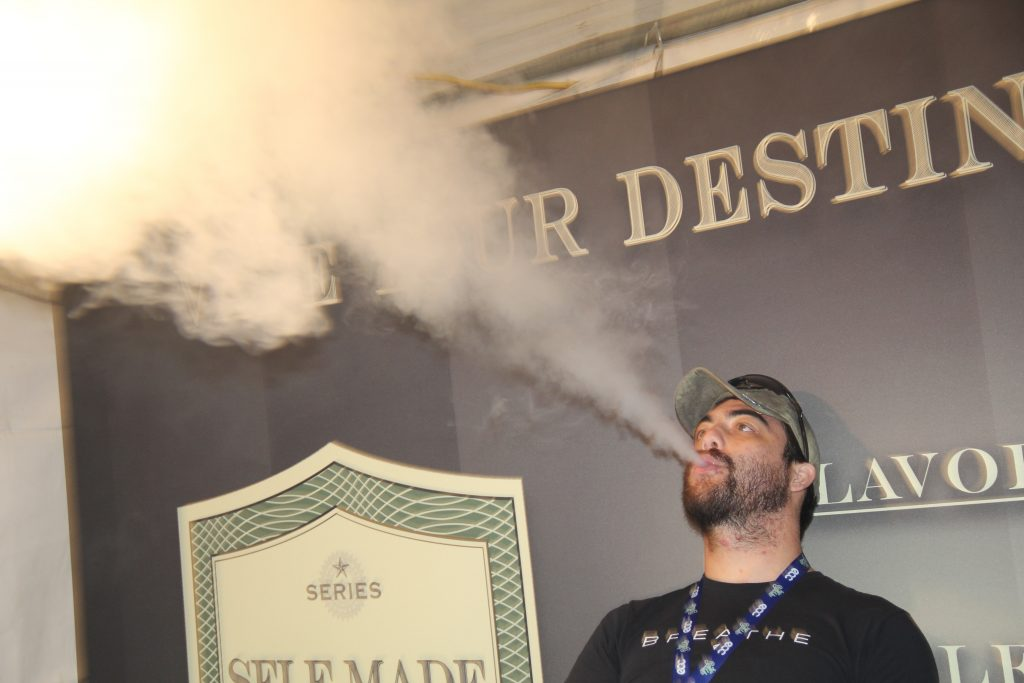 Self Made Vapors showcasing their clouds. Photo credit Clinton H. Wallace/DemiGoddessChronicle.com