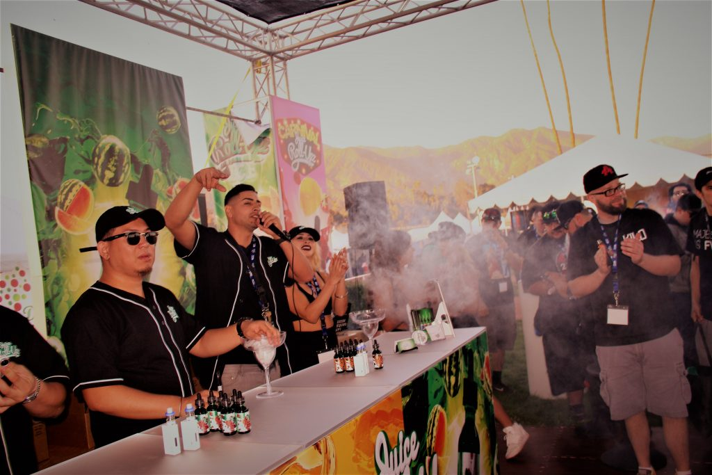 Juice Roll-Upz MC Chris Gonzales introduces vape cloud competition contestants. Photo credit Clinton H. Wallace/DemiGoddessChronicle.com