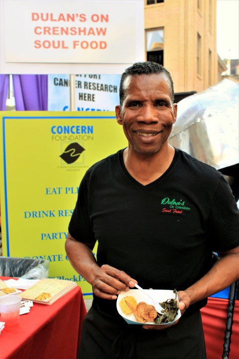 Gregory A. Dulan, owner of Dulans on Crenshaw, was serving up classic Southern and Soul food with all the fixings. Photo credit: DemiGoddessChronicle.com