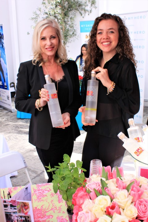 Spa Girl Cocktails owner Karen Haines (left) kept the party going with taste offerings for guests. Photo Credit: DGC