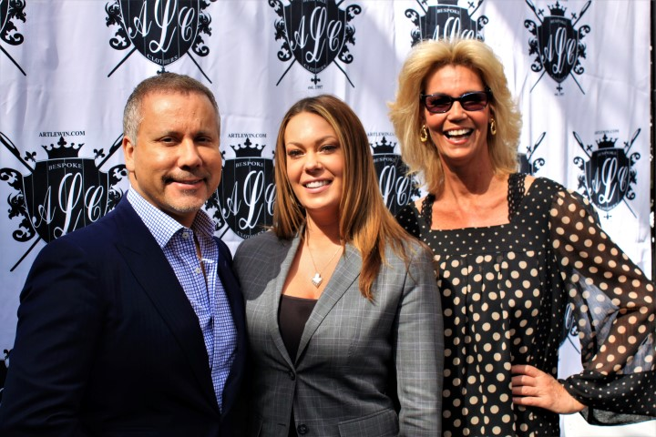 Bespoke custom clothier owners Art Lewin and his wife (center) with rep. Photo Credit: DGC