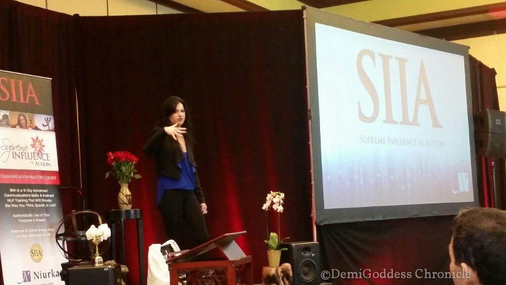 Niurka speaking to a crowd of enthusiastic participants for Supreme Influence, her one day training event. Photo credit: Demigoddess Chronicle