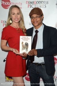 Demigoddess Chronicle Founders Christy Oldham and Clinton H. Wallace holding Literary work Finley & The Emerald Volcano. Photo Credit: David Edwards/DailyCeleb.com for DemiGoddessChronicle.com